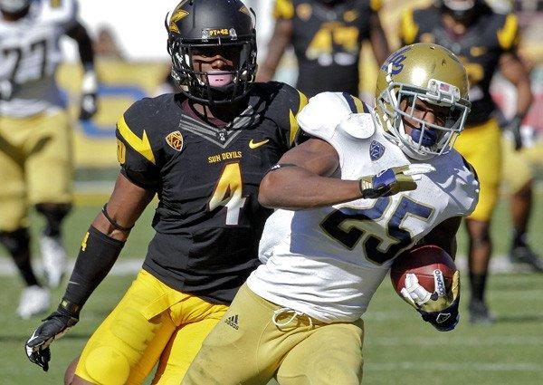 UCLA receiver Damien Thigpen pulls away from Arizona State safety Alden Darby for a scoring pass play in the second half Saturday.