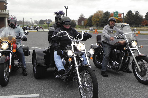 Motorcyclists roll out of M&S Harley-Davidson in Chambersburg, Pa., for Saturday's Ride to Read motorcycle ride in Franklin County to promote reading and literacy.