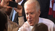 "In a gymnasium crowded with an estimated 1,500 supporters, Joe Biden urged voters to move his campaign and America ""forward."""