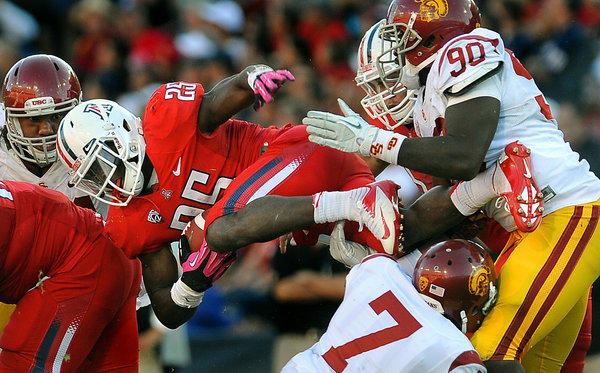 Arizona running back Ka'Deem Carey picks up a first down against USC late in the fourth quarter Saturday.