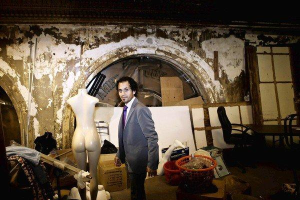 Developer Nick Hadim stands inside a storage area next to the Alexandria Hotel at 5th and Spring streets downtown. He plans to spend $3 million to transform the Alexandria's abandoned wing.