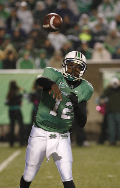 Marshall Thundering Herd quarterback Rakeem Cato (12) throws during the first quarter against the Central Florida Knights at Joan C. Edwards Stadium.
