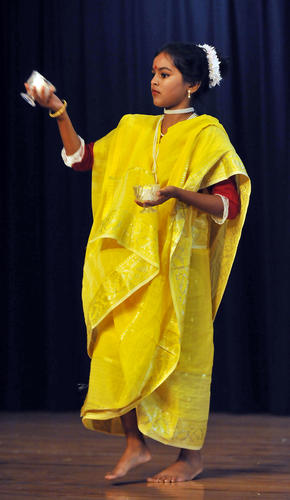 Samudrika Mohanta, of West Chester, Pa. dances a Hindi dance in a cultural program during a weekend long festivity called Durga Puja to welcome new deities at The Hindu Temple located at 4200 Airport Rd. in Allentown on Saturday evening.