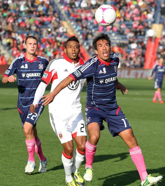 Lionard Pajoy of DC United and Pavel Pardo of the Fire fight for the ball at Toyota Park.