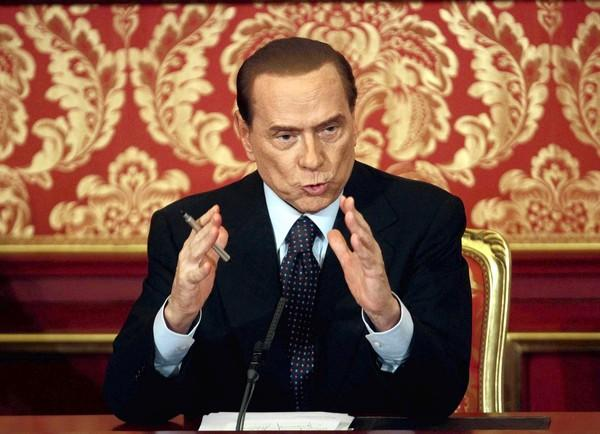 Former Italian Prime Minister Silvio Berlusconi gives a news conference Saturday at his villa near Milan. He was sentenced Friday to prison for tax fraud.