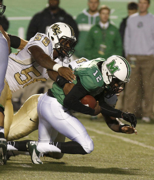 Marshall Thundering Herd quarterback Rakeem Cato (12) is sacked by UCF Knights defensive lineman Troy Davis (58) during the second quarter at Joan C. Edwards Stadium.