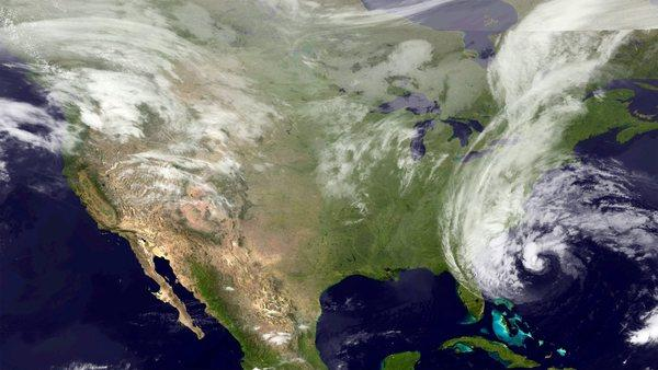 Hurricane Sandy, seen east of Georgia. The storm is forecast to track north and has caused the Obama campaign to cancel events in Virginia and Colorado.
