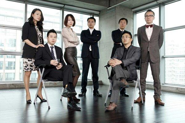"Employees of Ogilvy & Mather Advertising in Beijing dressed up for a ""Mad Men"" party held on November 4, 2011."