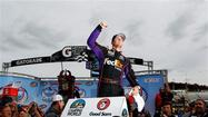 Denny Hamlin ducked under Matt Crafton with five laps to go and won the NASCAR truck series race at Martinsville Speedway.