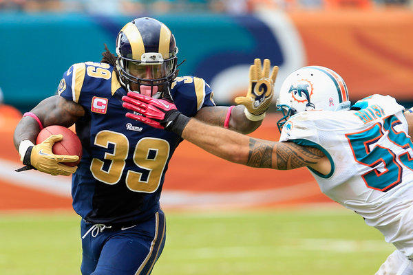 Rams running back Steven Jackson tries to get past Dolphins linebacker Koa Misi during a game last season in Miami.