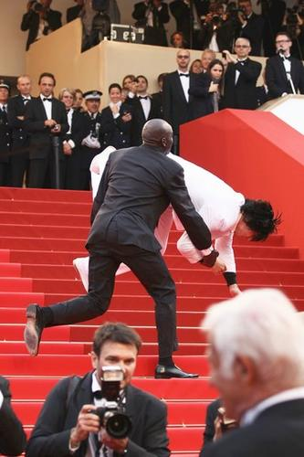 """Security tackles an intruder on the red carpet at """"The Beaver"""" screening."""