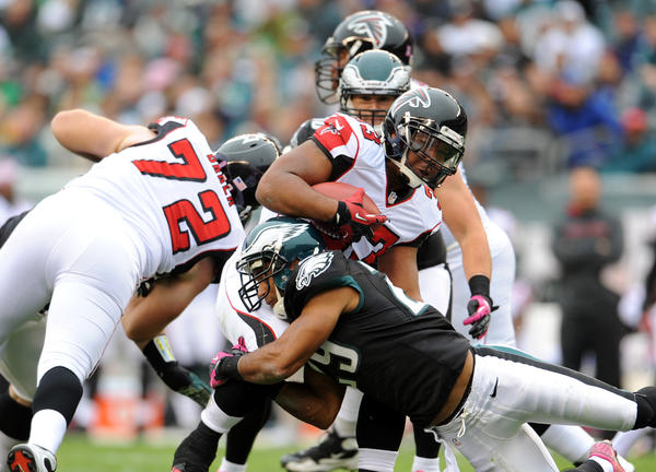 Atlanta Falcons running back Michael Turner (33) is tackled by Philadelphia Eagles strong safety Nate Allen (29) at Lincoln Financial Field in Philadelphia on Sunday.