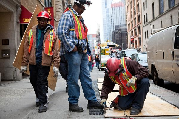 In preparation for Hurricane Sandy, construction workers cover air vents that could cause the New York subway system to flood. The MTA has announced that at 7 p.m. all subway, bus and commuter rail service will be shut down in response to the storm.