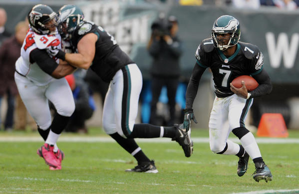 Philadelphia Eagles quarterback Michael Vick (7) runs against the Atlanta Falcons  at Lincoln Financial Field in Philadelphia on Sunday.
