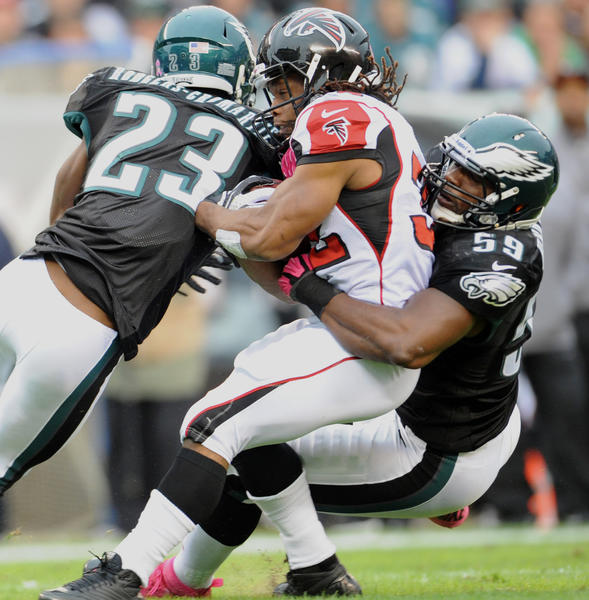 Philadelphia Eagles cornerback Dominique Rodgers-Cromartie (23) and Philadelphia Eagles middle linebacker DeMeco Ryans (59) tackle Atlanta Falcons running back Jacquizz Rodgers (32)  at Lincoln Financial Field in Philadelphia on Sunday.