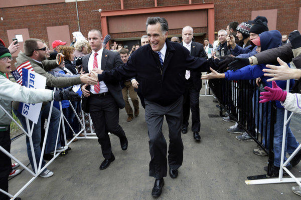 Mitt Romney arrives to speak to an overflow crowd of supporters as he campaigns at the Celina Fieldhouse in Celina, Ohio.