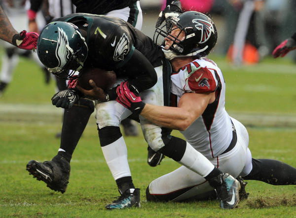 Philadelphia Eagles quarterback Michael Vick (7) is sacked by Atlanta Falcons defensive end Kroy Biermann (71) at Lincoln Financial Field in Philadelphia on Sunday.