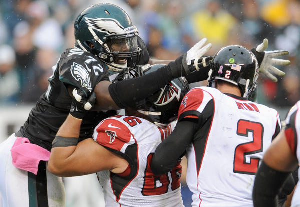 Philadelphia Eagles defensive tackle Cedric Thornton (72) reaches for Atlanta Falcons quarterback Matt Ryan (2) leading to a sack at Lincoln Financial Field in Philadelphia on Sunday.