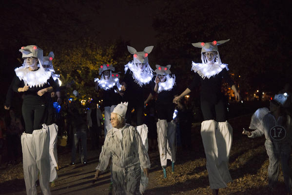 Stilt-walkers from The Nana Project, a Baltimore artistic parade and arts organization walk in the Lantern Parade at Patterson Park on Saturday. The Lantern Parade brought costumes of all sorts, families, artists, performers, and people for all over the city and the country to participate in this yearly Halloween celebration. The Nana Project has participated in the Lantern Parade from the beginning of the event.