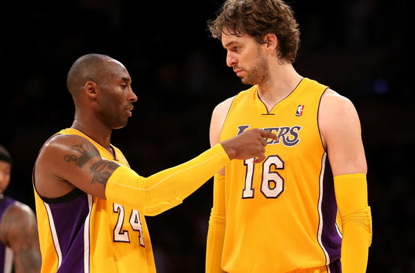 Lakers guard Kobe Bryant talks to power forward Pau Gasol during their exhibition game against the Kings.