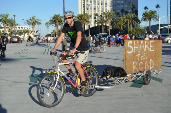 Kurt Bahneman of the OCC Food Riders Club and his dog Annabelle prepare to ride in a memorial Sunday for two Newport Beach cyclists who died in September.