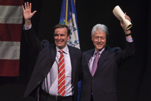 Chris Murphy, left, is running for a U.S. Senate seat and stands with former President Bill Clinton during a rally at the Palace Theater in Waterbury Sunday.