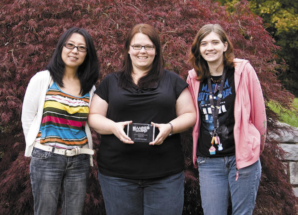 Three students from Hagerstown Community College won the 2012 American Institute of Graphic Artists MockUp Student Design Challenge. They are, from left, Yun Lee, Meredith Brown and Sarah Cimaglio.