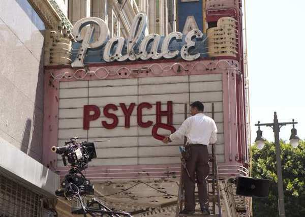 "An actor updates theater marquee at the Palace Theatre in downtown L.A. in a scene from ""Hitchcock."" Location manager Caleb Duffy won an award for his work on the movie."