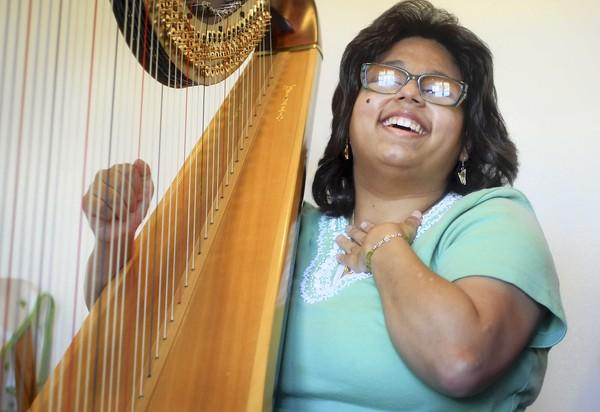 Mia Strayer, 21, who is visually impaired and has cerebral palsy, will play the harp in Special Talents America, a talent show for people with special needs, next week in Naperville.