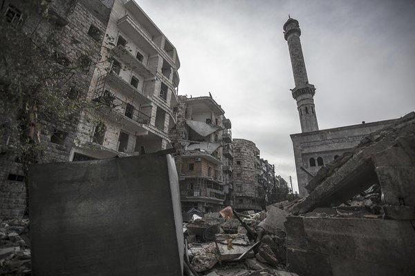 A mosque minaret still stands amid rubble from damaged buildings after an aircraft strike hit the mosque one week ago in the Tarik al-Bab neighborhood, southeast of Aleppo, Syria.