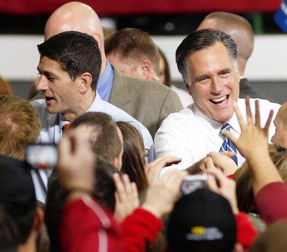 Republican presidential candidate Mitt Romney campaigns in Celina, Ohio. His conservative running mate, Paul Ryan, left, has taken a lower profile as Romney edges away from hard-line positions he took in the Republican primaries.