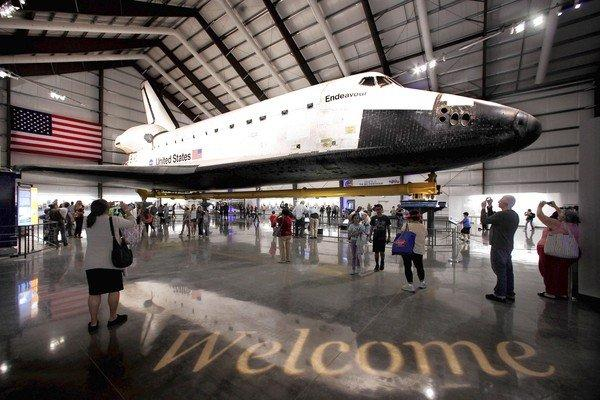 Visitors look up at Endeavour during a preview of the California Science Centers exhibit. The space shuttle is to be displayed this way until the museum builds a new wing to house it permanently.