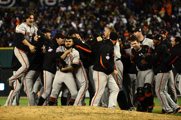 Ryan Theriot and his Giants teammates celebrate winning the World Series.