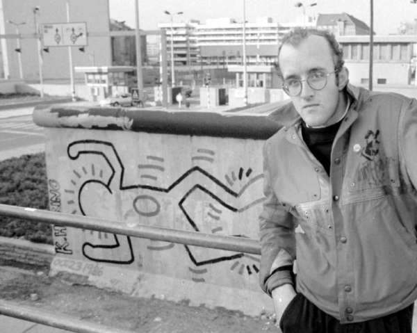The Keith Haring Foundation has awarded a $1-million grant to the Whitney Museum in New York. The late artist is shown in front of the Berlin Wall in 1986.