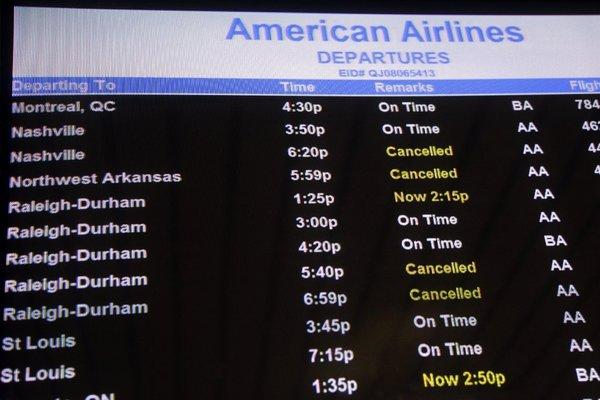 American has shut down operations at eight airports; more than 7,000 flights from all airlines have been canceled as a result of the expected superstorm menacing the East Coast.