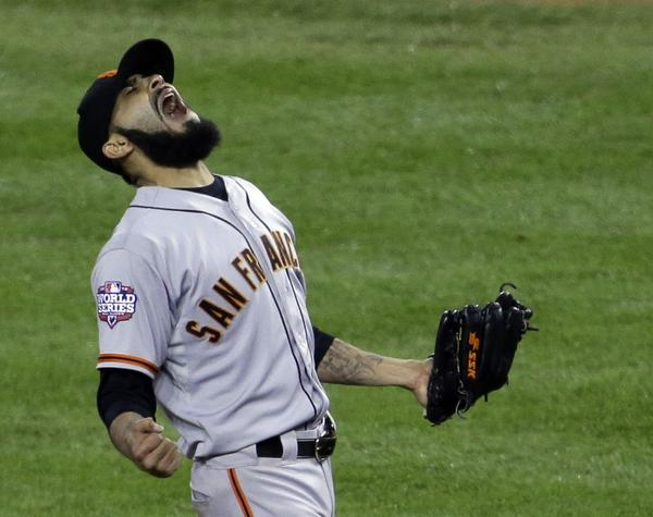 San Francisco Giants closer and Brawley native Sergio Romo reacts after striking out Detroit Tigers' Miguel Cabrera in the 10th inning of Game 4 of baseball's World Series on Sunday in Detroit. The Giants won the game 4-3 to win the World Series.