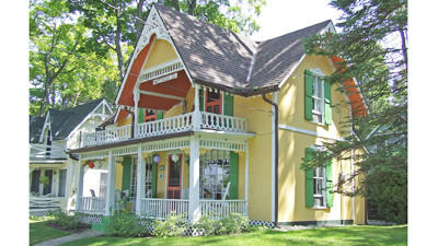 """This cottage is one of many with painted exteriors at the Bay View Association, which recently was judged to be among the """"Prettiest Painted Places in America."""""""