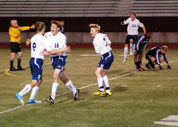 Petoskey's Anthony Hoffman (from left) Louis Lamberti, Eric Hoffman and Connor Ingleson celebrate moments following the Northmen's 1-0 overtime win over East Lansing Saturday in Midland in a Division II regional championship match. The Northmen will face Bloomfield Hills Cranbrook-Kingswood in a Division II state semifinal match at 6 p.m. Wednesday, Oct. 31, in Midland.