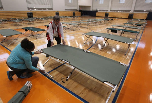 Red Cross workers set up cots inside the West Philadelphia High School gymnasium in Philadelphia. The school is being used as one of the city's shelters for residents as Hurricane Sandy makes its way up the Atlantic.