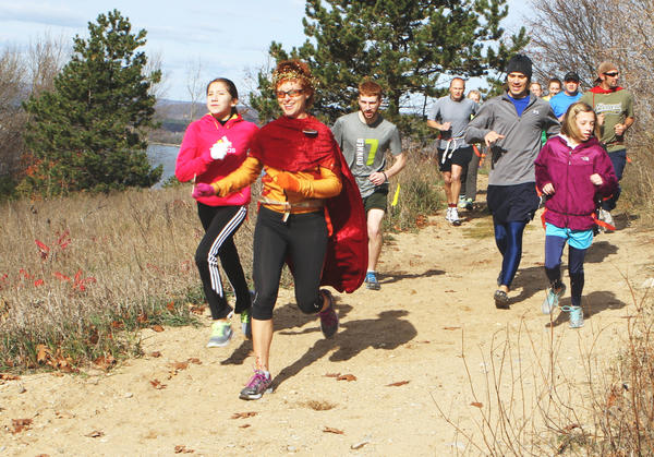 "Participants sprint with enthusiasm down the back of Avalanche hill prepared to out run the ""zombies"" Sunday during the Zombie Mountain Attack 5K at Avalanche Preserve in Boyne City. The second annual fundraiser benefits the Boyne City High School cross country and robotics teams."