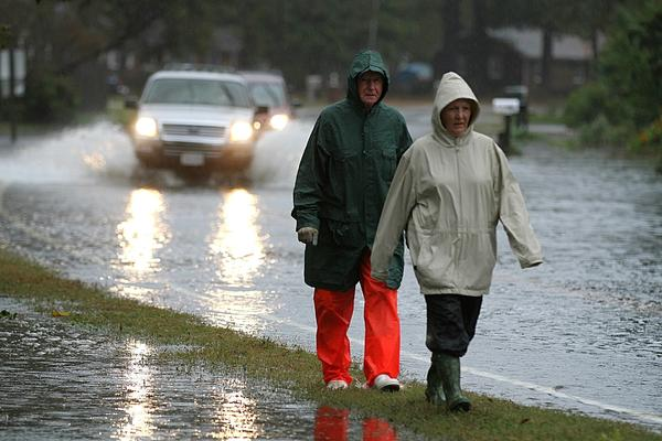 Barbara and Hedrick Gillikin walk to their car along Seaford Road in York County on Monday. The car was parked in a safe place about a mile from the couple's home.