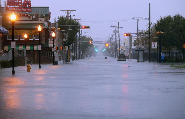 Water floods a street ahead of Hurricane Sandy on Monday in Atlantic City, N.J.