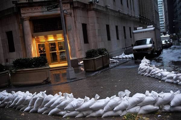 The closed New York Stock Exchange is barricaded with sand bags during the arrival of Hurricane Sandy in New York City. The core of Sandy's force is supposed to hit the New York area Monday night.