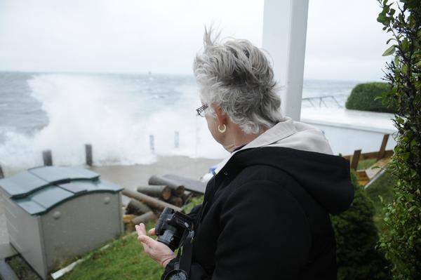 Tita Williams gets a close look at crashing waves near Ocean Beach.
