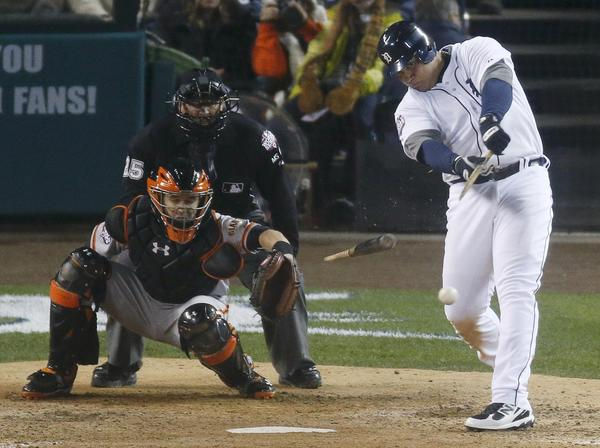 Detroit Tigers third baseman Miguel Cabrera breaks his bat in the eighth inning against the San Francisco Giants during Game 3 of the MLB World Series baseball championship in Detroit, Michigan, October 27, 2012.
