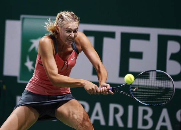 Russia's Maria Sharapova hits a return to Serena Williams of the U.S. during their final WTA tennis championships match in Istanbul, October 28, 2012.