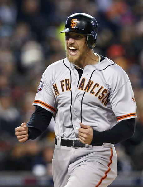 San Francisco Giants' Hunter Pence celebrates as he comes into score against the Detroit Tigers during the second inning of Game 4 of the MLB World Series baseball championship in Detroit, Michigan, October 28, 2012.