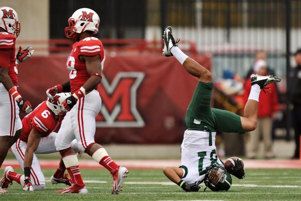 Landon Smith #87 of the Ohio Bobcats rolls on to his head after an 18-yard pass reception in the first half against Miami (OH) RedHawks at Yager Stadium on October 27, 2012 in Oxford, Ohio.