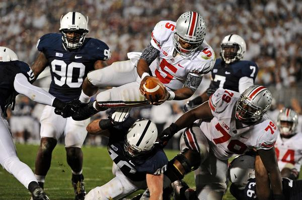 Quarterback Braxton Miller #5 of the Ohio State Buckeyes dives into the end zone for touchdown against the Penn State Nittany Lions in the third quarter at Beaver Stadium on October 27, 2012 in State College, Pennsylvania.