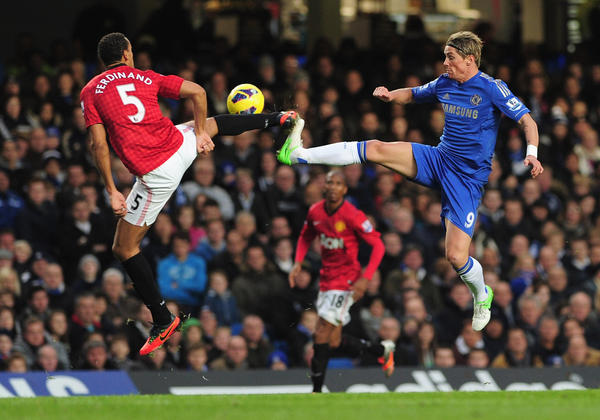 Fernando Torres of Chelsea challenges for the ball with Rio Ferdinand of Manchester United during the Barclays Premier League match between Chelsea and Manchester United at Stamford Bridge on October 28, 2012 in London, England.